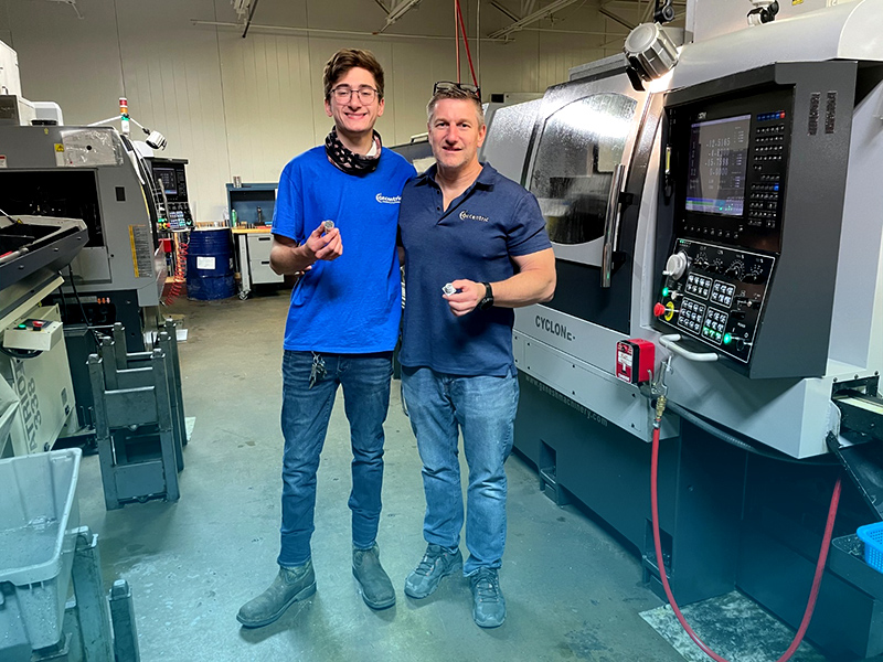 Father and son holding tools made with the CNC machine